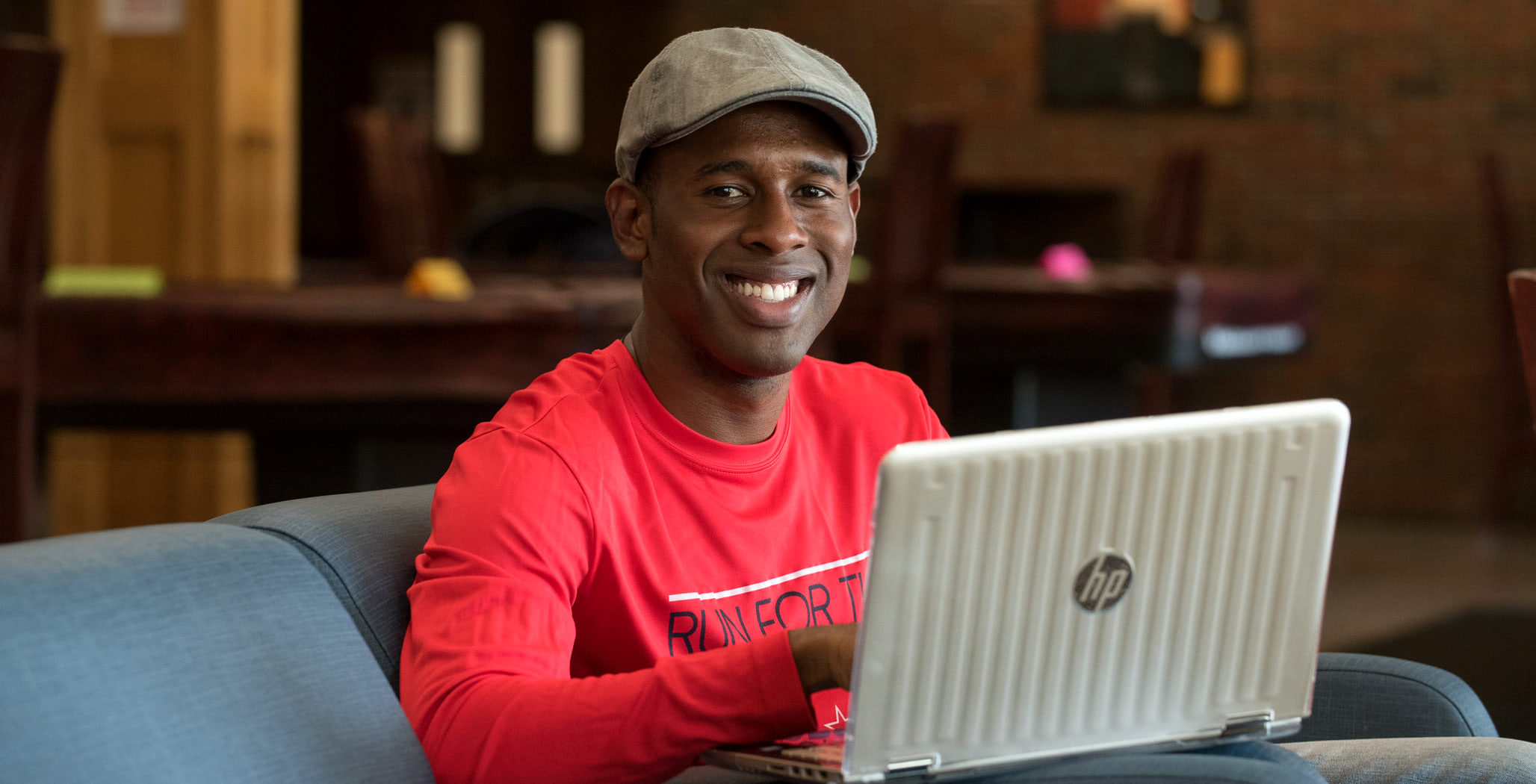 Man using laptop to complete his online degree