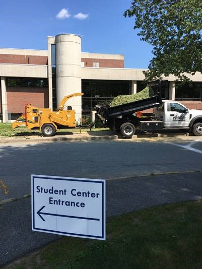 The Haverhill Campus Student Center Front Entrance with two large construction vehicles in front of the stairs.