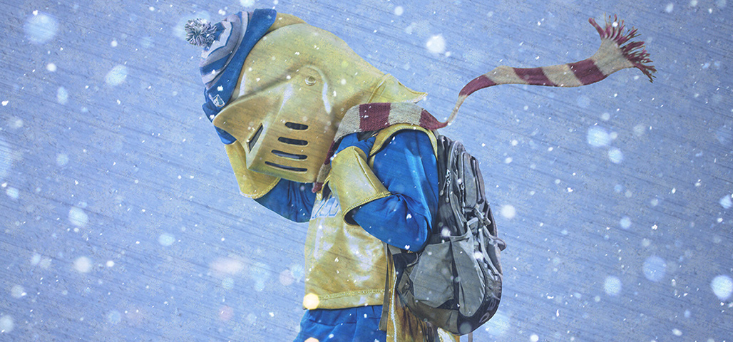 The NECC mascot tries to get to class in a blizzard