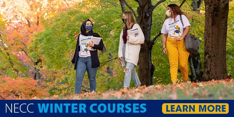 NECC Winter Courses Learn More Three students walking on campus in fall.